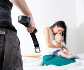 Men threating and beating his wife and child at home with a belt